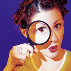 woman-looking-through-magnifying-glass